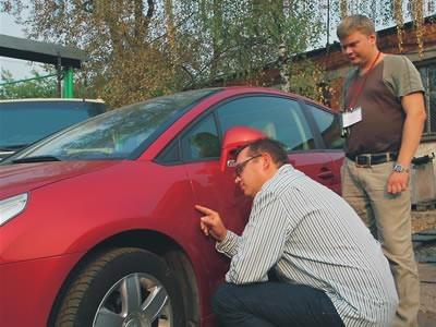 Проверка лакокрасочного покрытия автомобиля.